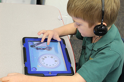 child using tablet in classroom